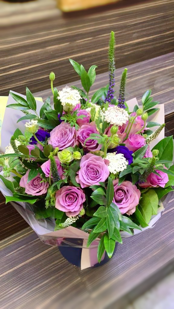Cute purple roses with colourful fillers