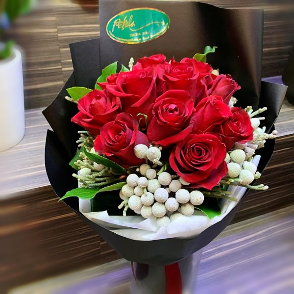 Passionate Red Roses with elegant black wrapping